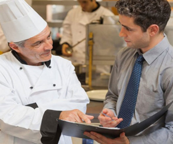 Two men discussing about Elevate restaurant accounting services Dubai